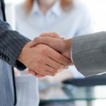 Close-up of businessmen shaking hands